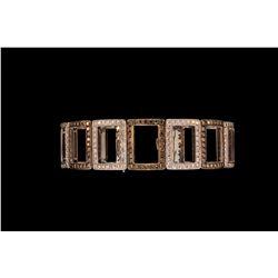 BRACELET: (1) Ladies 18k WG diamond bracelet 7 1/4  long of alternating white and champagne diamond