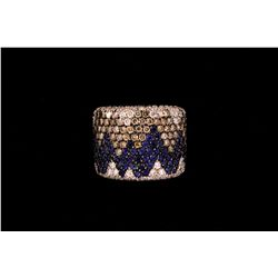 RING: (1) Diamond and sapphire 18k WG band 19.3mm wide, pave; set with (113) rbc champagne diamonds