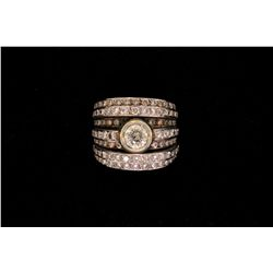RING: (1) Diamond and 18k WG ring. Bezel set in center is (1) rbc diamond, approx. 6.00mm in diamete