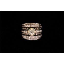 RING: (1) Diamond and 18k WG ring. Bezel set in center is (1) rbc diamond, approx. 6.00mm in diamete