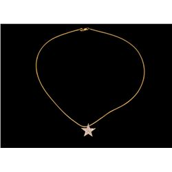 "PENDANT & NECKLACE:  (1) Diamond and 14ky star slide pendant and neck wire. Star is 3/4"", pave; set"