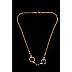 NECKLACE: (1) Diamond and 14ky and WG stirrup. Has WG circles at center pave; set with (38) rbc diam