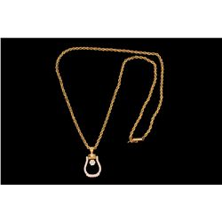NECKLACE: (1) Diamond and 14ky stirrup necklace. Prong set in stirrup is (1) rbc diamond 5.2 x 3.35m