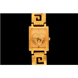 WATCH: (1) Gianni Versace Signature gold plated watch with open square link bracelet. Logo on face.