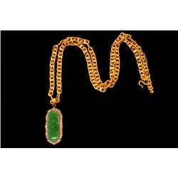"NECKLACE: (1) 18ky curb link chain and jade and diamond pendant in 14ky. Chain 22"" long x 5mm wide w"