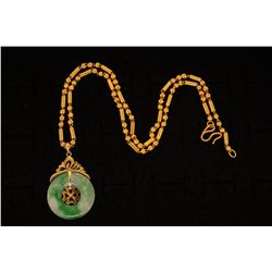 "NECKLACE: (1) 20ky chain necklace with jade and 14ky pendant. Chain is bead style 18"" long x 2.8mm w"