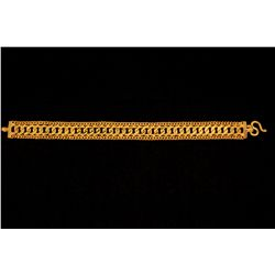 "BRACELET: (1) 22ky (stamped) 6.5"" long x 12.5mm wide with curb link center and edges, ""S"" clasp. 30."