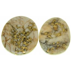 A pair of Gold Quartz Cabochons