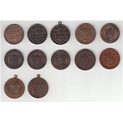 Lot of 12 Societe des Artisans Medals.