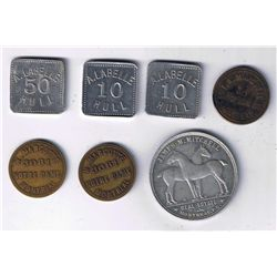 Lot of 7 Quebec trade tokens.