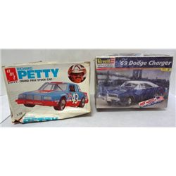 2 MODEL CAR KITS.  BOXES NOT IN GOOD COND.  CARS STILL NICE.