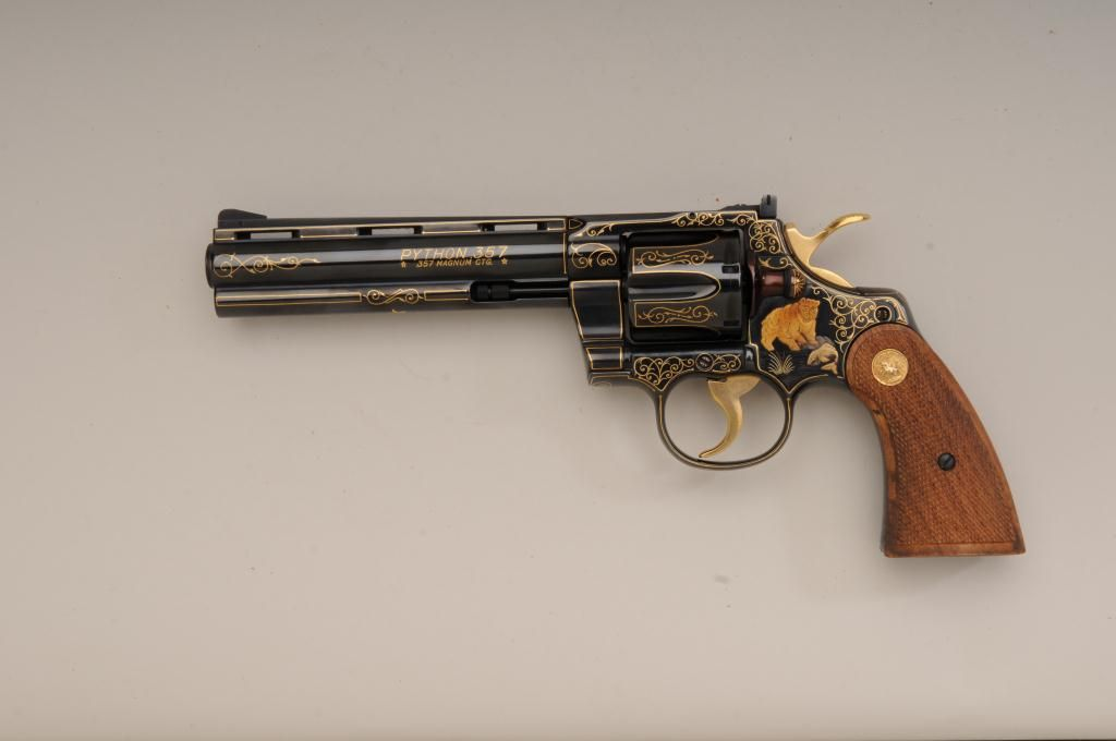 """Colt Python  357 Magnum double action revolver with 6"""" barrel that is fully  and finely gold inlaid"""