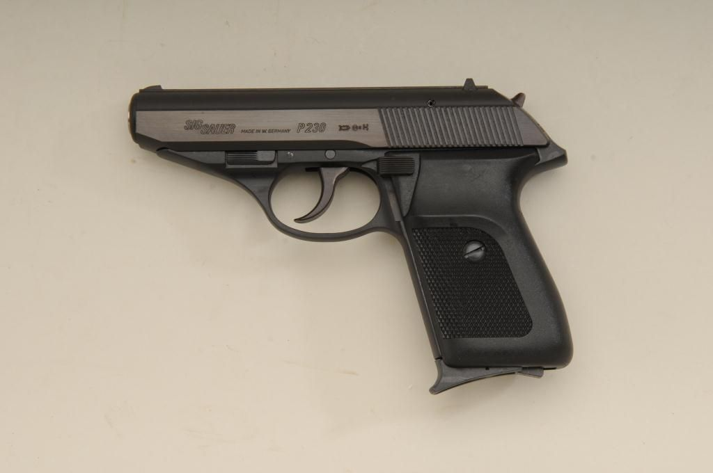 """Sig Sauer Model P230 made in West Germany,  380 auto cal , 3-3/4"""" barrel,  black finish, checkered"""