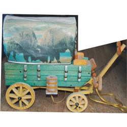 Folk art covered wagon lamp