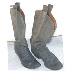 circa early 1900's high top cowboy boots
