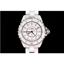 WATCH:  [1] White ceramic ladies Chanel J12 quartz watch; #JH 86707; bezel is damaged on the surface