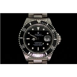 ROLEX: Men's st.steel Rolex O.P. Submariner Date wristwatch; black dial w/ lumin markers; unidirecti