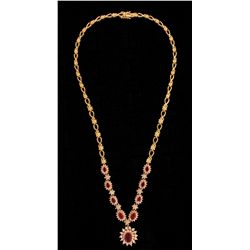 NECKLACE:  [1] 14KYG (stamped) necklace set with 9 oval faceted rubies, approx. 4.37cttw., commercia
