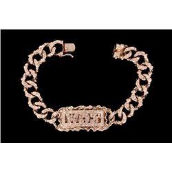"BRACELET:  [1] 14KWG nugget link band identification bracelet with the frame and initials ""WDJ"" set"