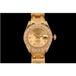 ROLEX: Lady's 18ky Rolex O.P. Datejust MasterPiece wristwatch w/ aftmkt diamond bezel; dial w/ 10 rd