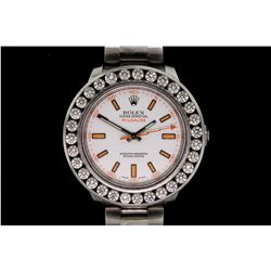 ROLEX: Men's st.steel Rolex O.P. Milgauss wristwatch w/ aftmkt channel set diamond bezel; 31 rb dias