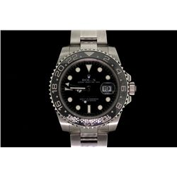 WATCH:  [1] Stainless steel gents Rolex GMT Master II Date watch with a black dial and bezel; model