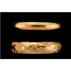 BRACELET:  [1] 14KYG hinged bangle bracelet with engraved large cats and textured finish; 20.5 grams