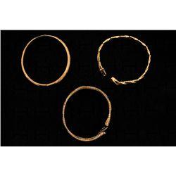 BRACELET:  [1] 14KYG hinged bangle bracelet with engraved and textured finish; 9.3 grams BRACELET: