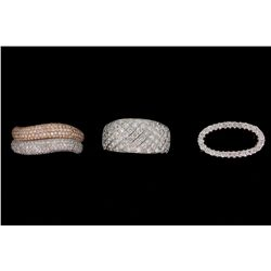 RING: Lady's 18kw&r pave diamond fashion ring; 400 rb dias, 0.7mm - 1.1mm = est 1.37cttw, Good/G-I/S