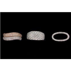 RING: Lady's 18kw&r pave diamond fashion ring; 400 rb dias, 0.7mm - 1.1mm = est 1.37cttw, Good/G-I/S