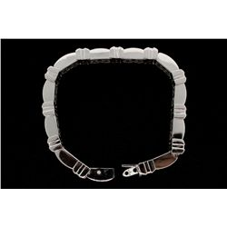 "BRACELET: Gents 14kw ""invisible"" set diamond link bracelet; 703 sq prin dias, 1.2mm to 1.3mm = est 8"