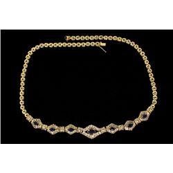 NECKLACE:  [1] 14KYG necklace set with 7 oval cut blue sapphires and 236 baguette cut diamonds, appr