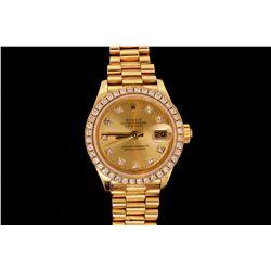ROLEX: Lady's 18ky Rolex O.P. Datejust wristwatch w/ aftmkt diamond bezel; champagne dial w/ 10 rd d