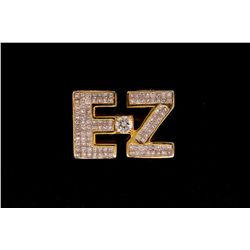 "RING: Lady's 14kw (yellow plated) initial ""EZ"" invisible set diamond ring; 1 (ctr) rb dia, 5.0mm = e"