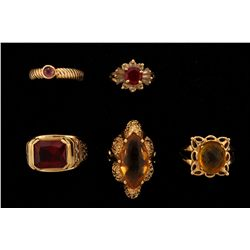 RING:  [1] 10KYG ring set with a synthetic red stone and synthetic clear stones; size 8 1/4; 3.2 gra