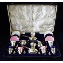 A CASED SILVER & CERAMIC COFFEE SET: comprising two coffee pots with  tapering turned wood handle...