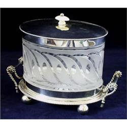 AN OVAL EPNS BISCUIT BOX: the stand with rope twist handles, the  cover and base beaded and with...