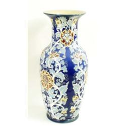 A VERY LARGE ORIENTAL POTTERY URN: with abundant bright floral and  foliate decoration on a deep...