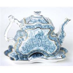 AN UNUSUALLY SHAPED VICTORIAN TEA POT: with matching stand, flat  sided, transfer printed in gree...