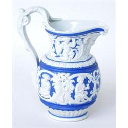 A VICTORIAN MOULDED STONEWARE MASKHEAD JUG: with ornate rustic goats  head mask handle, having a...