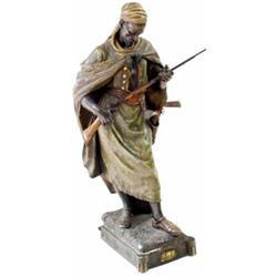 A FINE GOLDSCHEIDER FIGURE: of an Arab warrior, complete with  flintlock rifle and two flintlock...