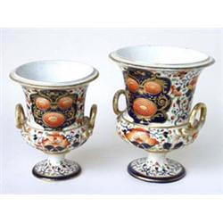 """TWO GRADUATED DERBY CAMPANA SHAPED URNS: with snake handles,  decorated in the Imari palette, 8""""..."""