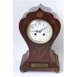 AN EDWARDIAN INLAID MAHOGANY MANTLE CLOCK: with French eight day  movement striking to gong, the...