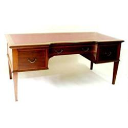 AN EDWARDIAN MAHOGANY INLAID AND SATIN BANDED BREAKFRONT WRITING  DESK: the top inset a red skive...