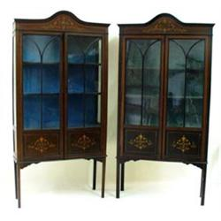 A PAIR OF EDWARDIAN MAHOGANY DISPLAY CABINETS: with arched moulded  pediment over a simulated inl...