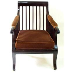 A REGENCY MAHOGANY LIBRARY CHAIR: with plain crest rail and slatted  back and arm supports, the a...