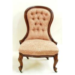 A VICTORIAN MAHOGANY BUTTON BACK NURSING CHAIR: with serpentine seat,  the cabriole front legs ra...