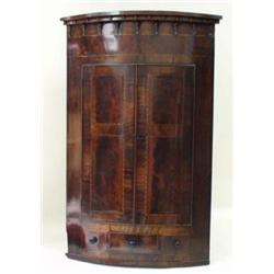 A GEORGIAN MAHOGANY AND STRING INLAID HANGING CORNER CUPBOARD: with  moulded cornice and frieze,...