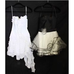 Lot [2] DRESSES:  [1] Faviana strapless black dress, size 4 and [1] Juan Carlos Pinera Corset dress