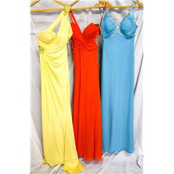 Lot [3] DRESSES:  [1] Jovani yellow dress, size 2, [1] Faviana red dress, size 2 and [1] Faviana blu